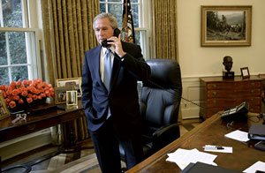 President George W. Bush on the phone