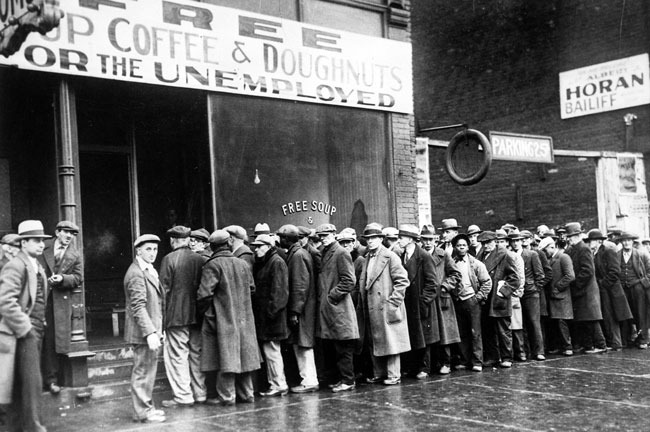 Black and white photo of men in a bread line during the Great Depression