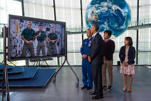 Obama watches space station video