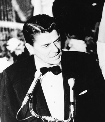 Ronald Reagan in tuxedo at microphone in 1967