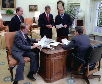 Ronald Reagan meeting with staff in Oval Office