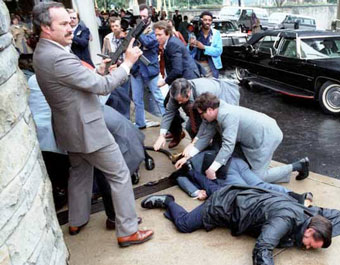 Just after the assassination attempt on US President Ronald Reagan, 30 March 1981, outside the Washington Hilton Hotel. James Brady and police officer Thomas Delahanty lie wounded on the ground.