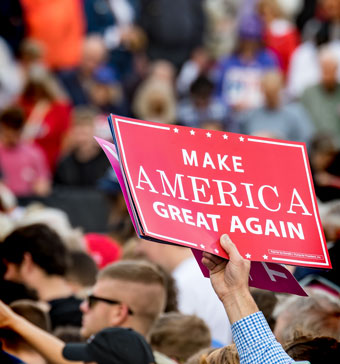 """Make America Great Again"" sign held above a crowd"