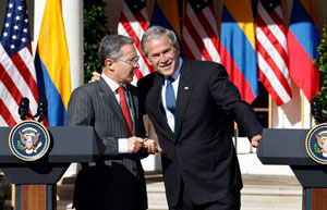 President George W. Bush shaking hands with President Uribe of Colombia