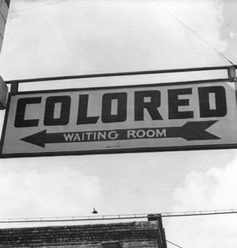 """Colored"" sign with an arrow"