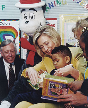 Hillary Clinton reading to a child