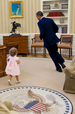 President Obama running in the Oval Office with a small child chasing him