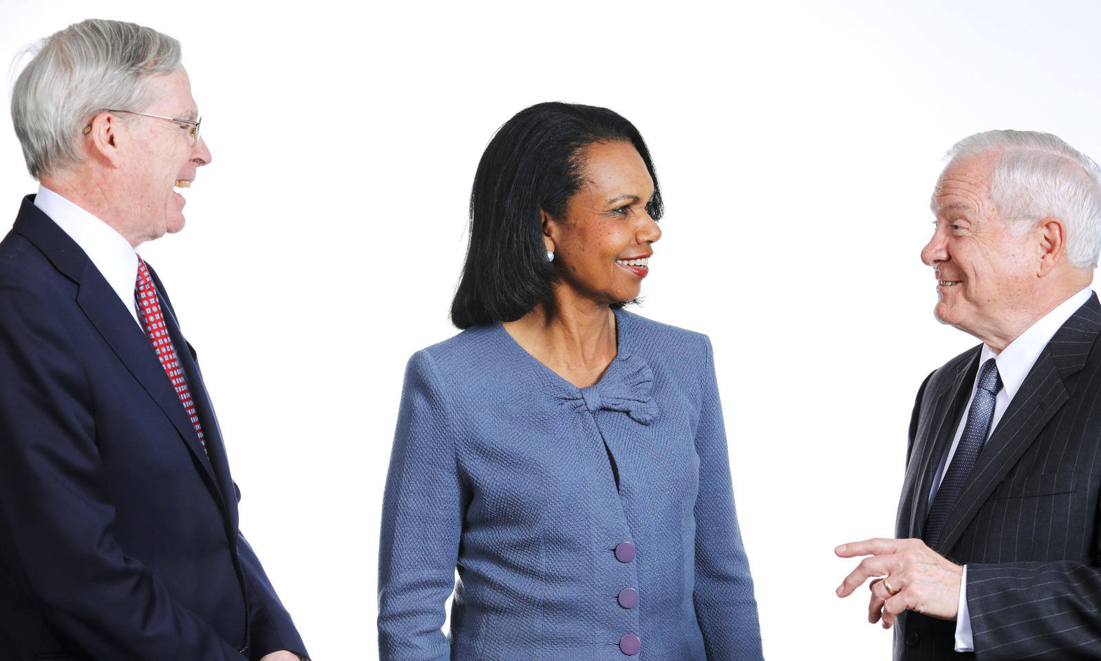 Stephen Hadley, Condoleeza Rice, and Robert Gates talking to each other