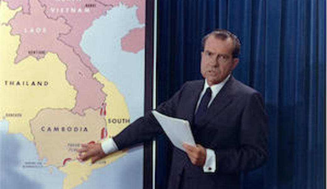Richard Nixon pointing at map of Southeast Asia