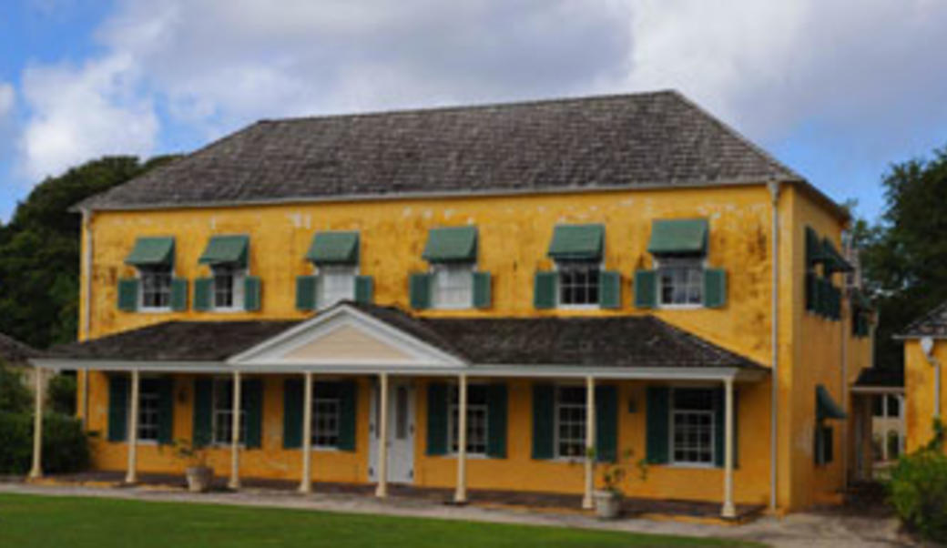 Yellow house with green shutters