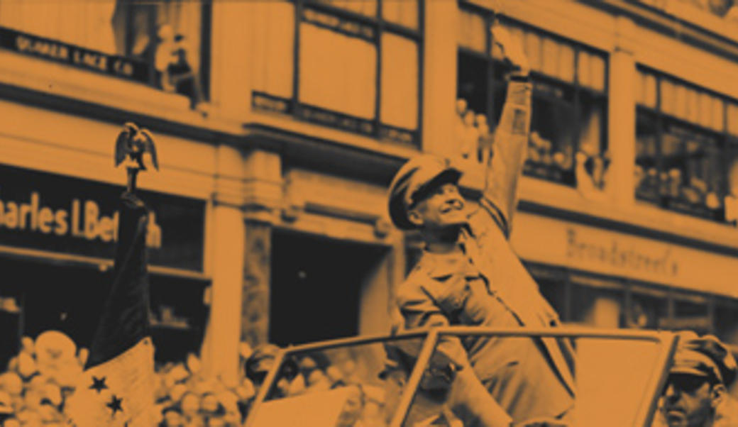 Eisenhower waving from car during a parade
