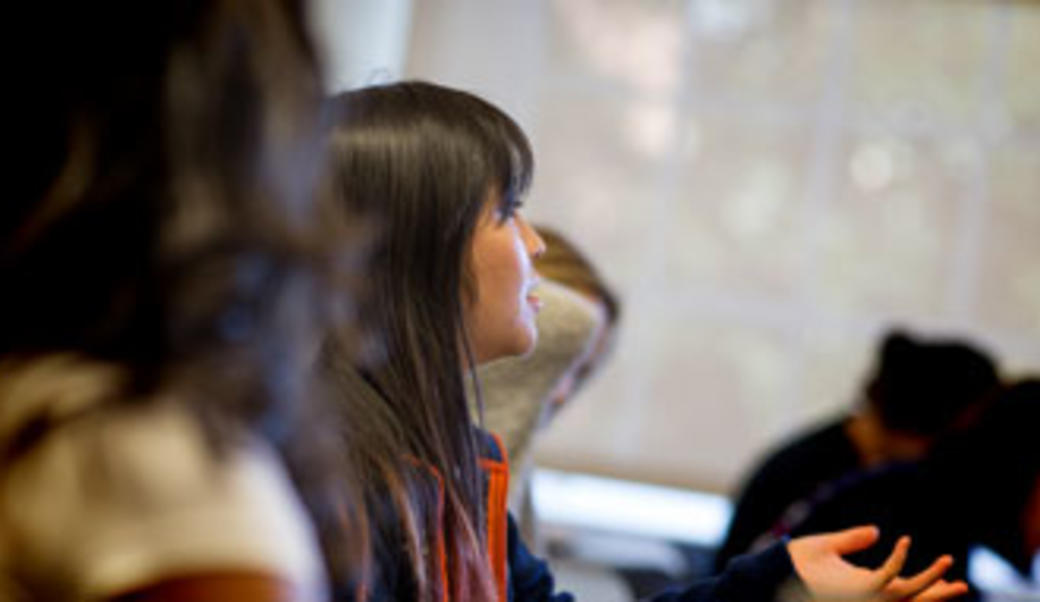 Student looking ahead to listen to a Miller Center presentation