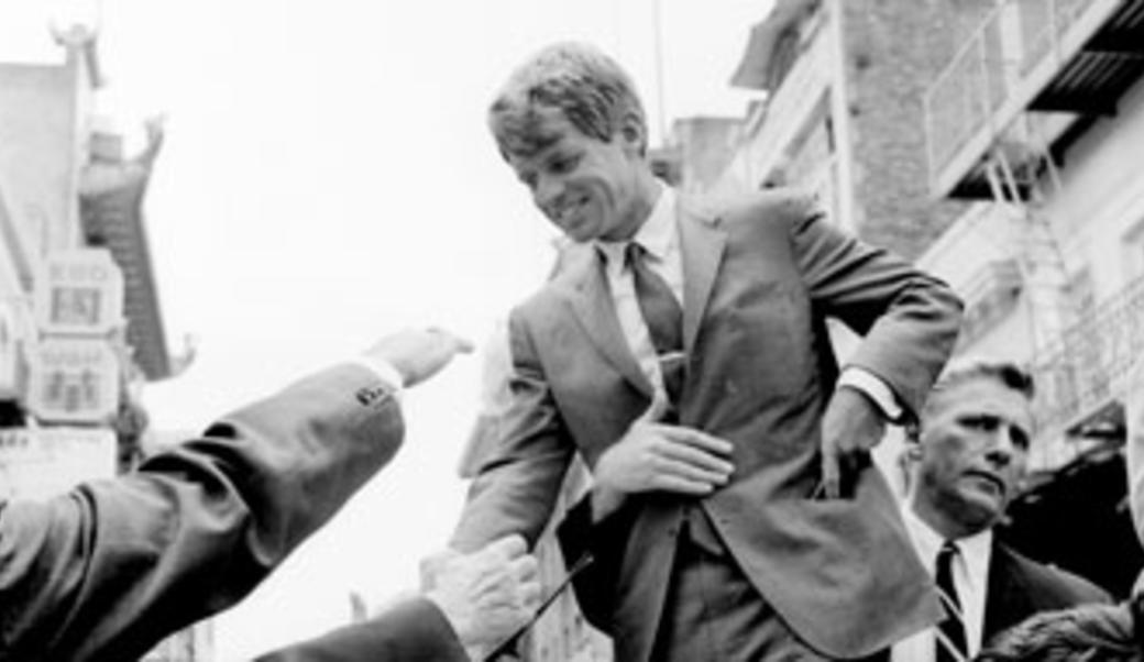 RFK shaking hands with the public
