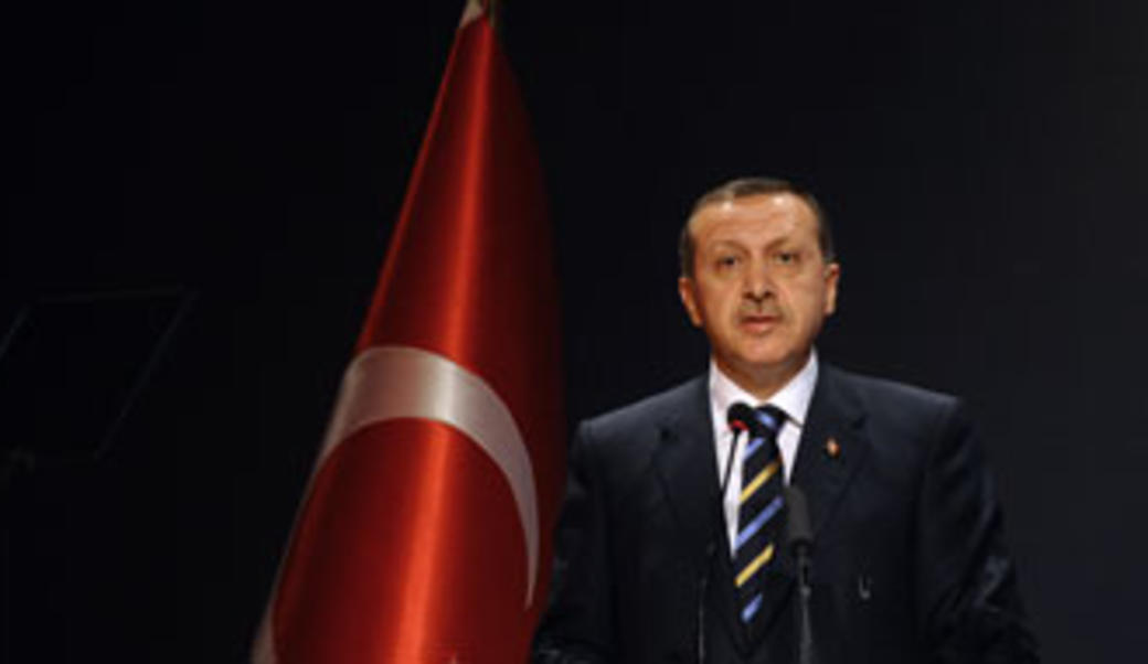 Turkey's President Erdoğan in front of nation's flag