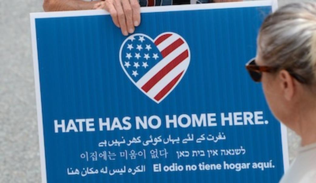 """hate has no home here' sign"