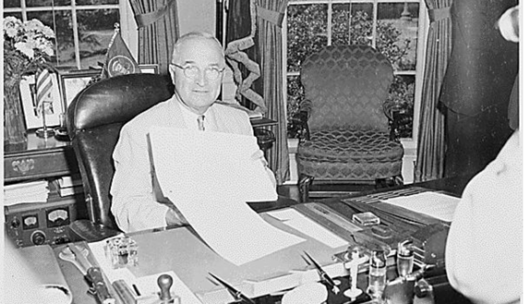Truman displaying the National Security Act Amendments of 1949