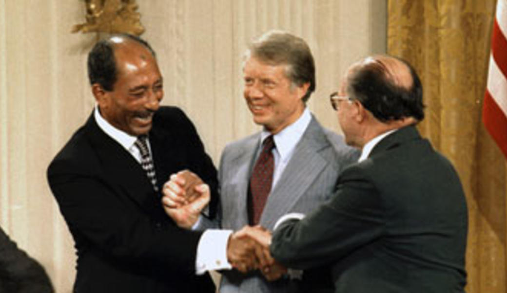 Anwar Sadat, President Carter, and Menachem Begin sign Camp David Accords