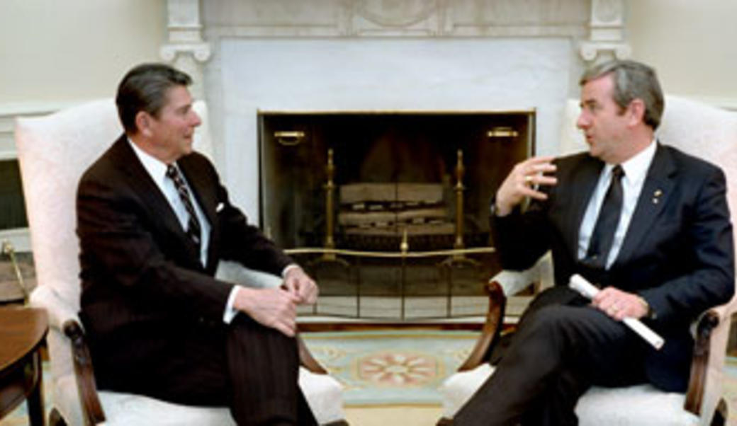 Ronald Reagan sits with Jerry Falwell