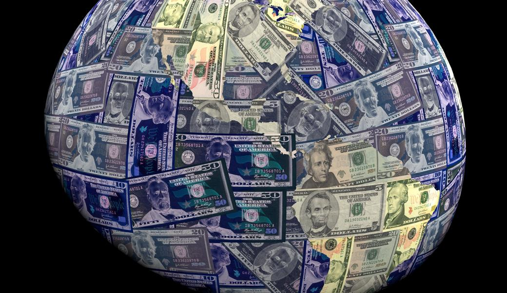 globe with USA currency overlay