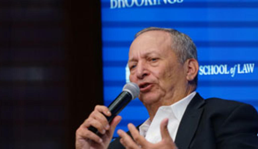 Larry Summers speaking into a microphone