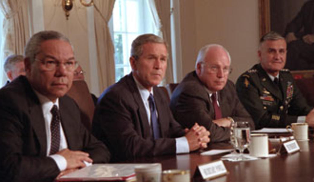 President Bush at table with advisors