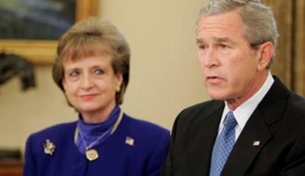 George Bush with Harriet Miers standing to his left