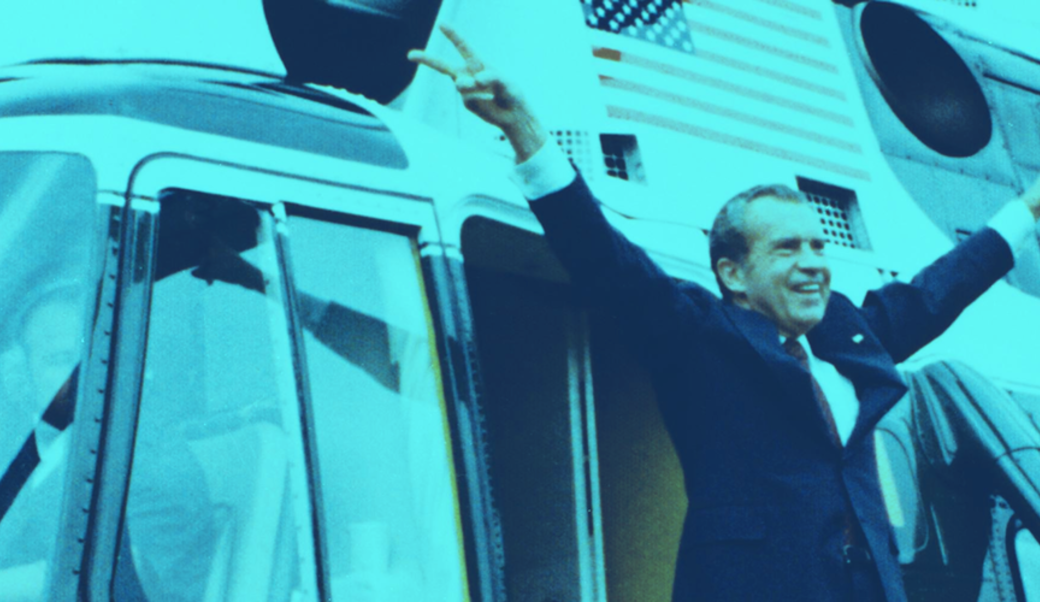 Nixon waving goodbye in front of helicopter
