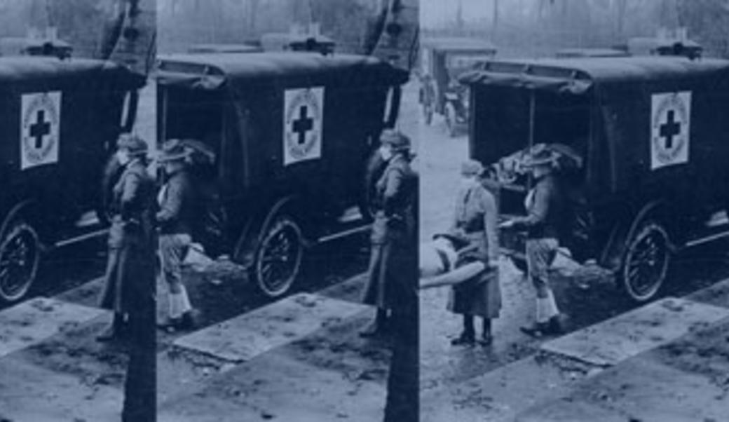 Nurses loading soldier into ambulance in 1918