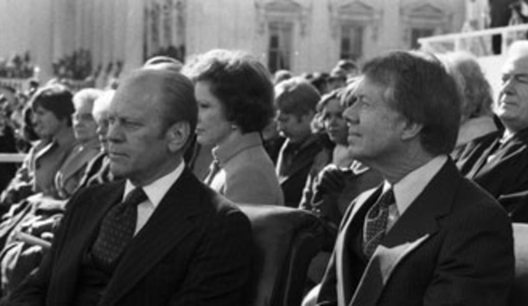 Gerald Ford and Jimmy Carter sitting next to each other
