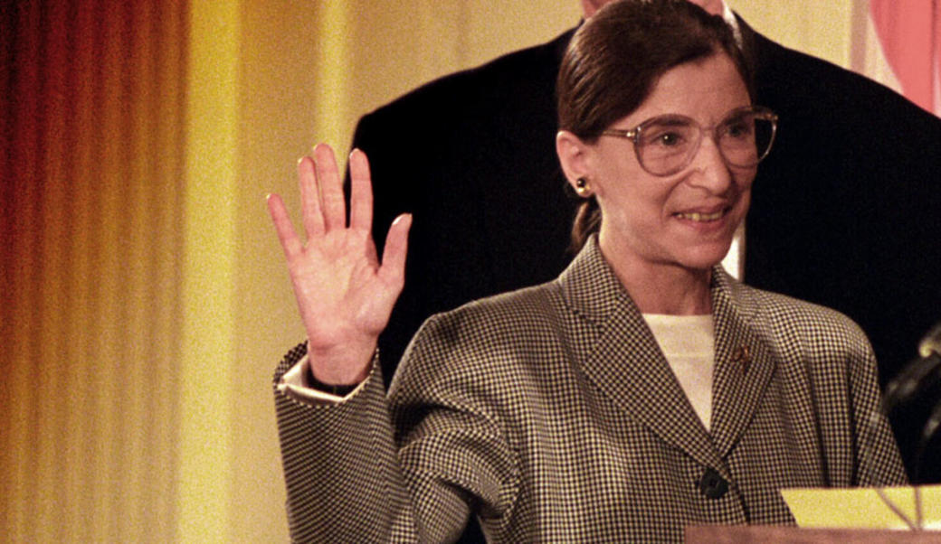 Ruth Bader Ginsburg with right hand raised