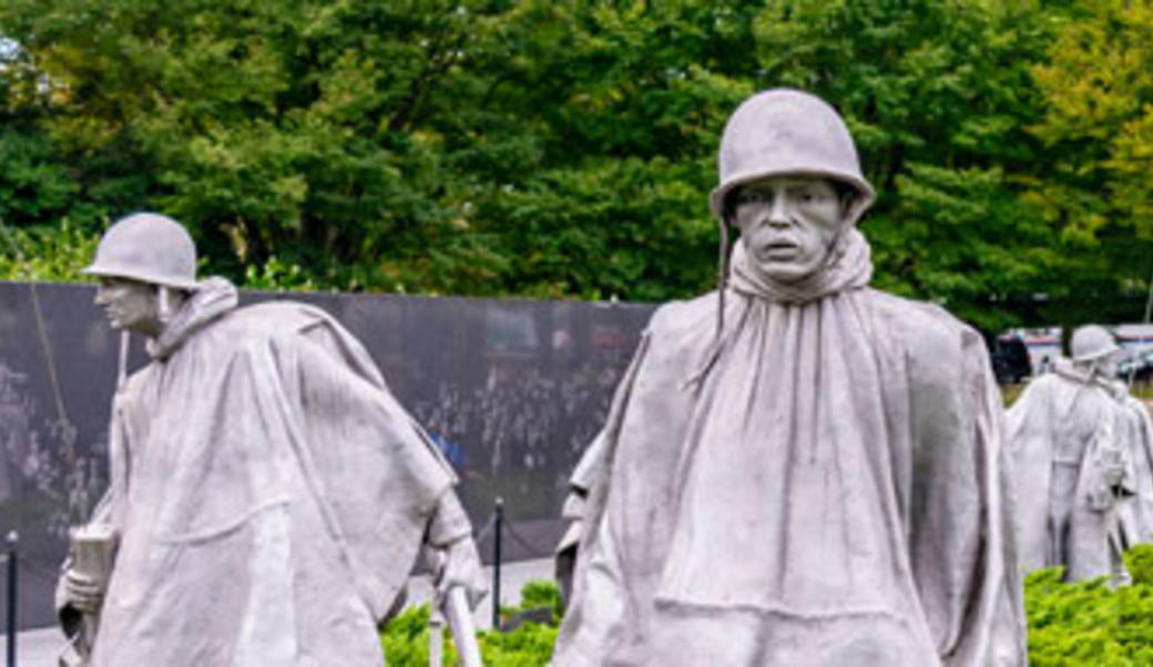 statues of soldiers in a field