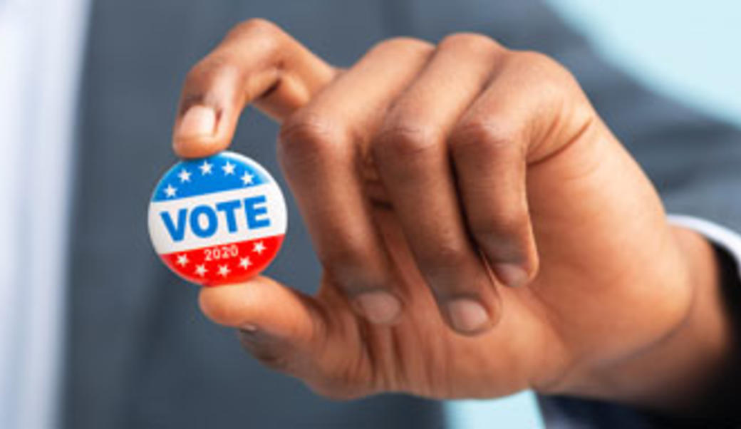 "hand holding up ""vote"" button"