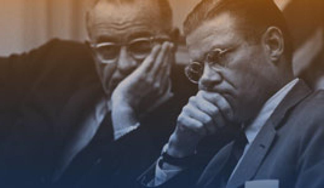 Lyndon Johnson and Robert McNamara looking grim