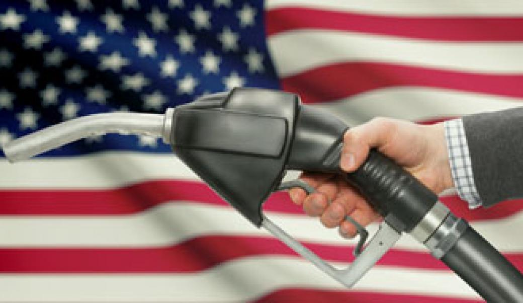 Gas pump in front of flag