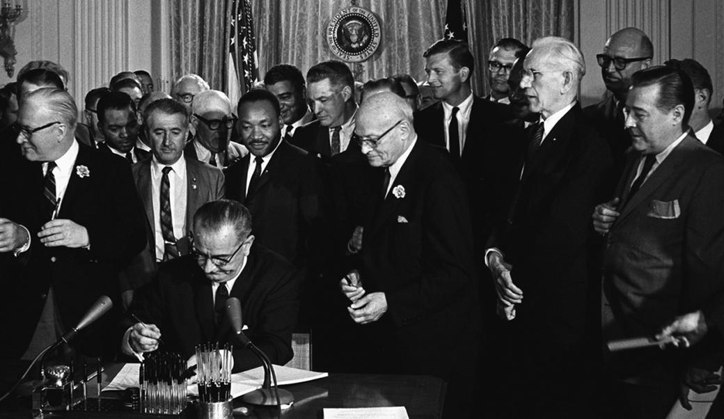 LBJ Signing Civil Rights Act of 1964 with Martin Luther King and others in the white house.