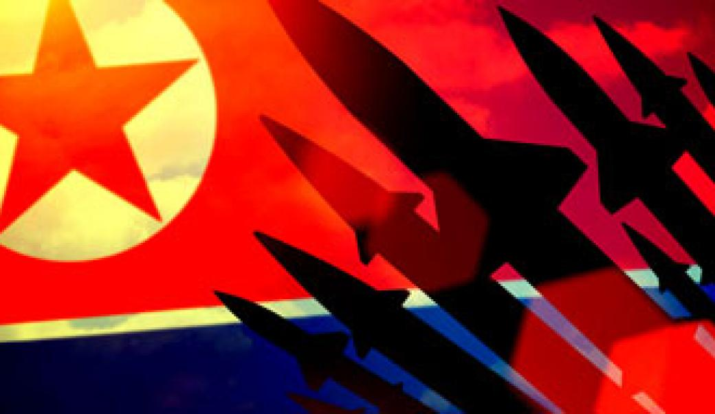 A segment of the North Korean flag with missile silhouettes
