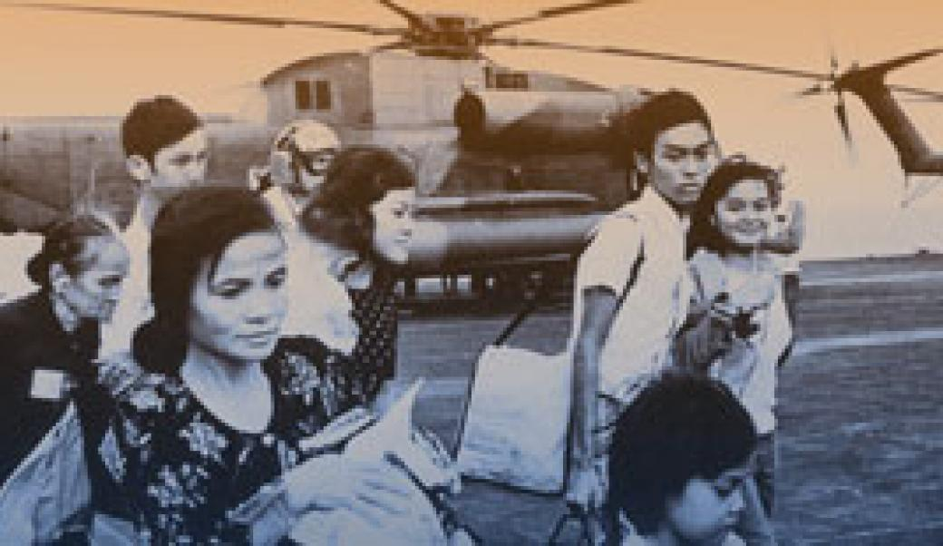 Vietnamese evacuees on board ship helicopter in background