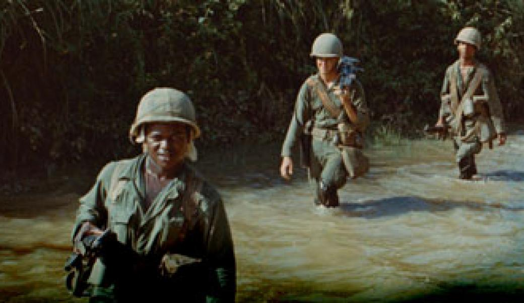 Soldiers walking through a river in Vietnam