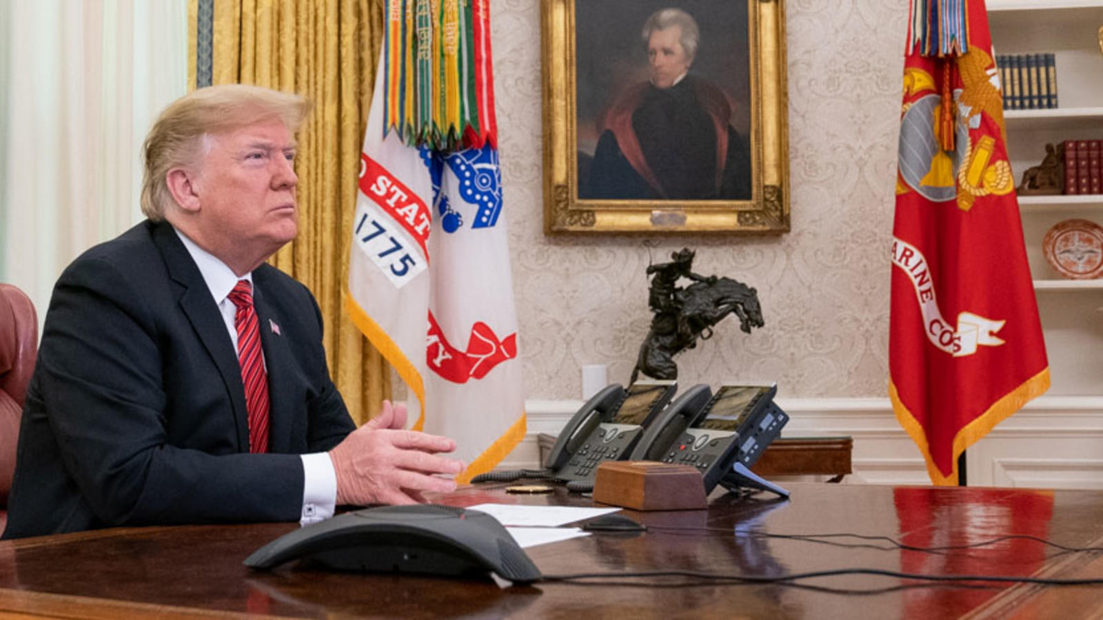 President Trump sits in the Oval Office