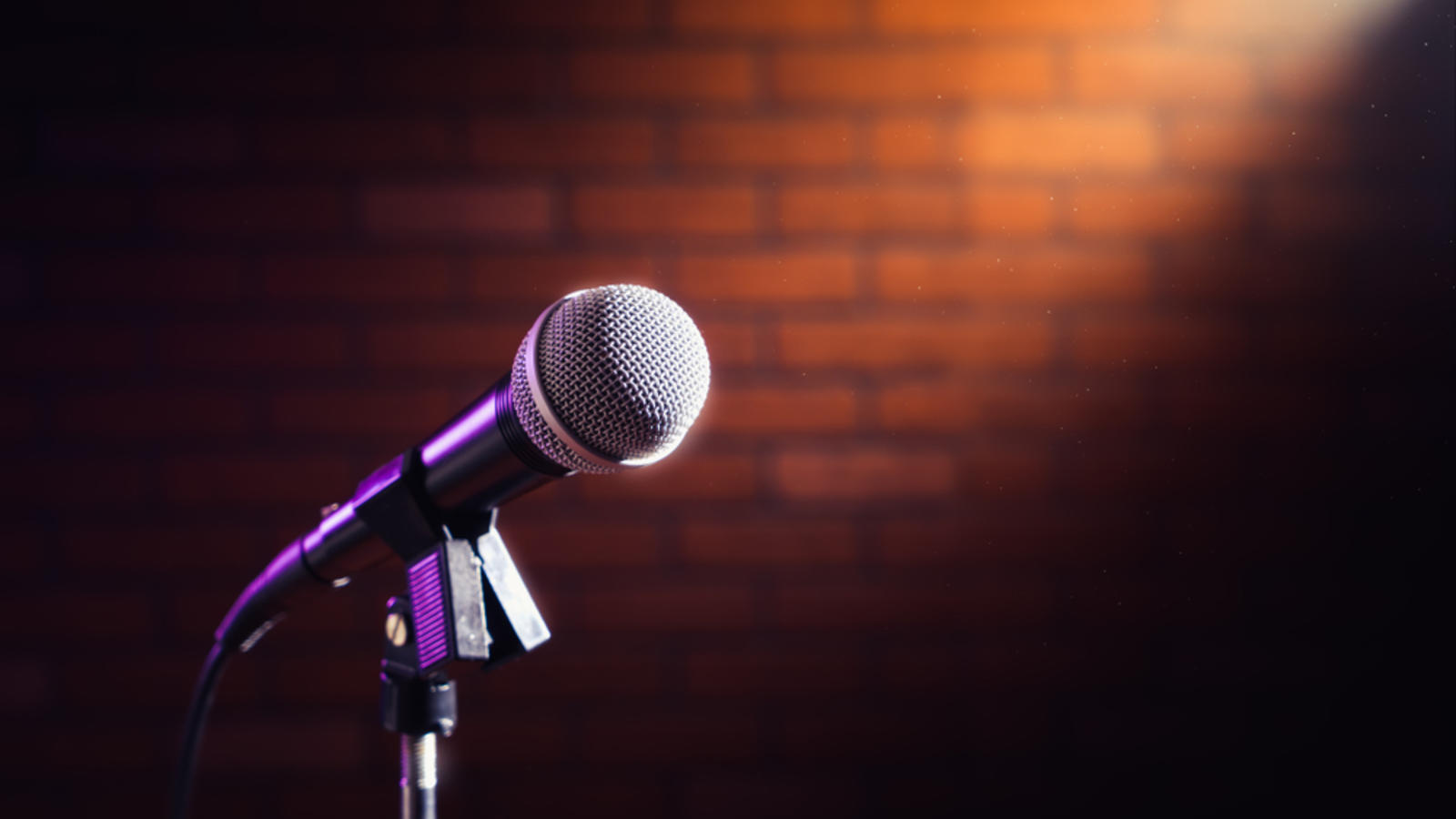 a mic against a red brick wall